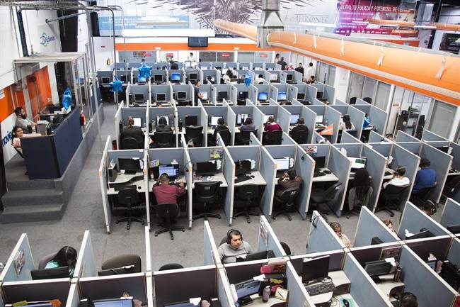 Automation Featured Image: A large office bull pen with dozens of workers in cubicles.