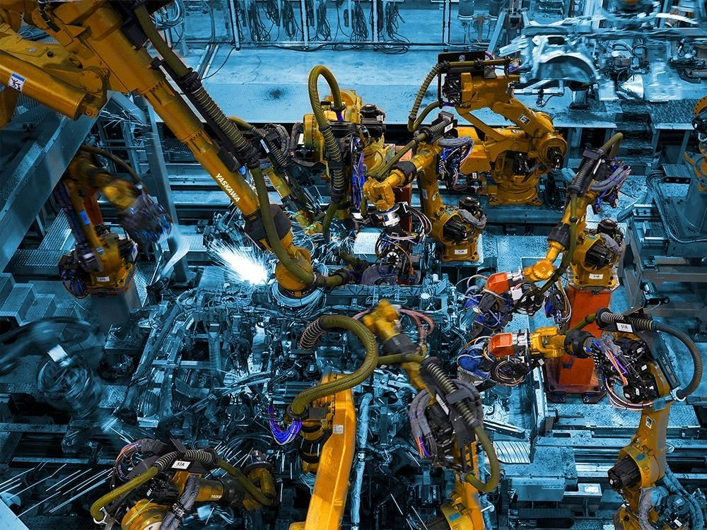 Featured Image: Ontario's manufacturing sector - A robot in every factory - A large intricate robot on a manufacturing line